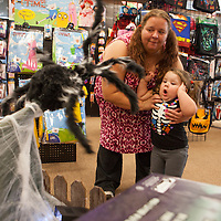 """Serenity leaps back when a giant spider darts out from a web in the ``Spirit of Halloween"""" costume store in Dardenne Prairie, MO. Halloween is big holiday in the Jenkins house where all family members wear costumes."""
