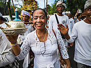 20 JULY 2016 - KUSAMBA, BALI, INDONESIA:  Balinese Hindus participate in a procession to a nearby temple after a ceremony on Kusamba beach. Several hundred Balinese Hindus gathered on the beach in Kusamba, Bali, for a ceremony to honor the full moon. They prayed for more than hour and then community leaders threw an offering into the ocean.      PHOTO BY JACK KURTZ