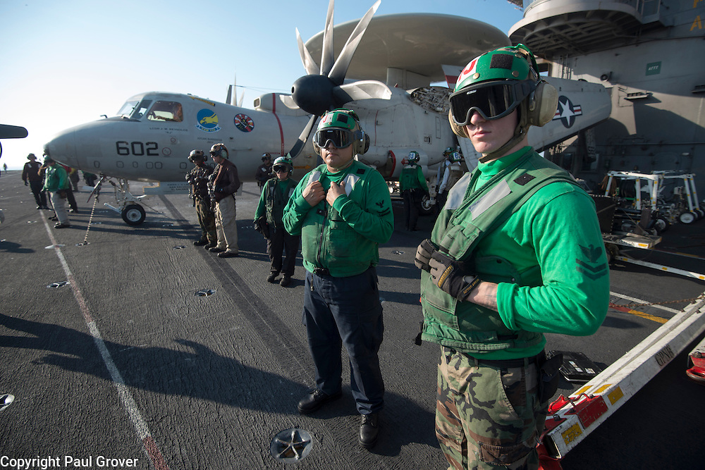 USS John C Stennis CVN-74 Aircraft Carrier.Pic Shows Flight and Hangar Deck personnel wait for aircraft to land