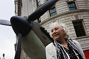Once the wartime armed forces sweetheart, Dame Vera Lynn makes an appearance near a replica Spitfire fighter plane at the 70th anniversary of WW2 Battle of Britain. Seventy years ago, Winston Churchill made one of his most stirring speeches in Parliament to praise the Battle of Britain aircrews who had fought off the threat of Nazi invasion during the summer of 1940. In the 1940s, Dame Vera's personality warmed those fighting abroad, her voice singing some of the most stirring ballads that allied soldiers, sailors and airmen heard to remind them of home. Here she stands beneath the full-size model of the Merlin-powered propeller of this iconic fighter that helped stop a full-scale Nazi invasion of the British Isles.
