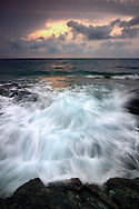 the rising tide of mid  September, increased in power by the northwestern wind known as Mistral, wipes out the beautiful rocky coast of the Cap Corse near to Barcaggio, right at the northern tip of Corsica.