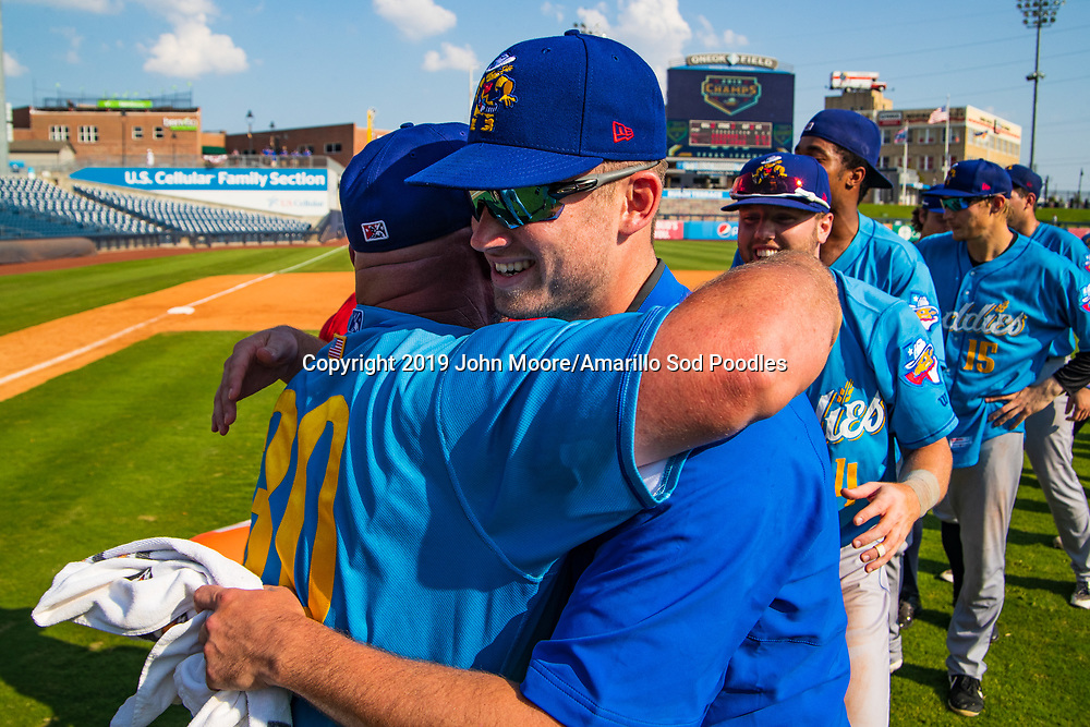 Amarillo Sod Poodles Manager Phillip Wellman and Amarillo Sod Poodles pitcher Aaron Leasher (32) celebrates after the Sod Poodles won against the Tulsa Drillers during the Texas League Championship on Sunday, Sept. 15, 2019, at OneOK Field in Tulsa, Oklahoma. [Photo by John Moore/Amarillo Sod Poodles]