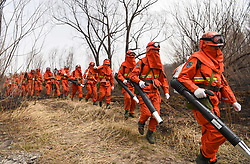 May 4, 2017 - Hulun Buir, China - Police officers and firefighters head for Beidahe forest farm in the Greater Hinggan Mountain region, north China's Inner Mongolia Autonomous Region. Nearly 5,000 firefighters are battling a fire in north China's Inner Mongolia Autonomous Region, which broke out at 12:15 p.m. Tuesday.  wyl) (Credit Image: © Lian Zhen/Xinhua via ZUMA Wire)