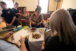 Tammy Hulme, second from left, Gina Renfroe and Deanna Lambka, all of Lodi, Calif., serve up samples of their gourmet Spam chips and dip at the 22nd annual Spam Festival, Sunday, Feb. 16, 2019, in Isleton, Calif. Spam lovers competed for prizes by presenting their favorite Spam-infused foods, or entering the Spam-eating and Spam-toss contests. (Photo by D. Ross Cameron)