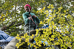 Daniel Marc Hooper, better known as environmental activist Swampy, hauls up food to a makeshift tree house about sixty feet above ground at a wildlife protection camp in ancient woodland at Jones' Hill Wood on 5 October 2020 in Aylesbury Vale, United Kingdom. The Jones' Hill Wood camp, one of several protest camps set up by anti-HS2 activists along the route of the £106bn HS2 high-speed rail link in order to resist the controversial infrastructure project, is currently being evicted by National Eviction Team bailiffs working on behalf of HS2 Ltd.