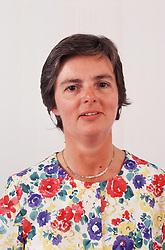 Portrait of woman wearing floral print dress,