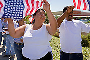 """01 MAY 2006 - PHOENIX, AZ: About 1000 immigrants gathered on a street corner in Phoenix at a Home Depot store during a protest in favor of immigration reform during the """"Day without Immigrants"""" protest in Phoenix. About 1,000 people picketed the corner, which had been a popular gathering spot for day laborers until Home Depot took action to keep day laborers off their property. Immigrants rights groups picketed two Home Depot stores, a pallet manufacturing plant and a public school during the protest. Photo by Jack Kurtz"""