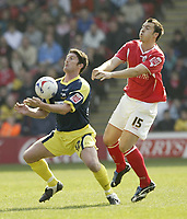 Photo: Aidan Ellis.<br /> Barnsley v Derby County. Coca Cola Championship. 31/03/2007.<br /> Derby's Jon Macken (L) holds off Barnsley's Antony Kay