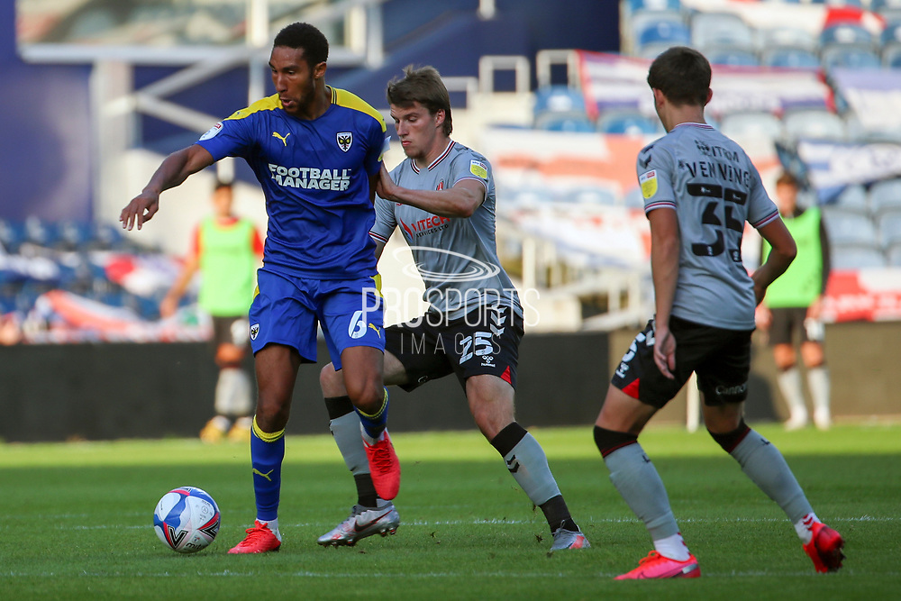 AFC Wimbledon defender Terell Thomas (6) battles for possession during the EFL Trophy Group O match between AFC Wimbledon and Charlton Athletic at the Kiyan Prince Foundation Stadium, London, England on 1 September 2020.