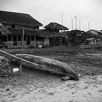 Small fishing boats line the beach in Mompiche.