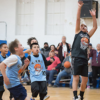 In Gallup, Jonah Jones of the Spurs hits the game winning shot against the Blue Devils in the Gallup Youth Basketball League tournament on at the Larry Brian Mitchell Recreation Center Saturday.