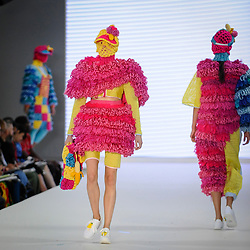 © Licensed to London News Pictures. 04/06/2018. London, UK.  A model presents a look by Lola Downing from Birmingham University on day two of Graduate Fashion Week taking place at the Old Truman Brewery in East London. The event presents the graduation show of up and coming fashion designers from UK and international universities.  Photo credit: Stephen Chung/LNP