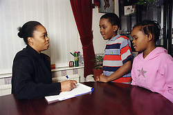 Social worker with young children,