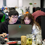 Nai Nai, a 23-year-old live-streamer in Shanghai, China, talks with her agent Wang Jianbing. Nai Nai's fans are mostly Chinese men between 15 and 30 years old who post messages and virtual gifts, visible to everyone logged on to her chatroom. China's livestreaming industry reached 425 million subscribers in 2018 out of a current total internet user base of more than 829 million, according to government statistics cited in Chinese state media. Livestream hosting is an increasingly popular career choice, especially for young Chinese women like Nai Nai.