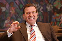 09 JAN 2002, BERLIN/GERMANY:<br /> Gerhard Schroeder, SPD, Bundeskanzler, waehrend einem Interiew, in seinem Buero, Bundeskanzleramt<br /> Gerhard Schroeder, SPD, Federal Chancellor of Germany, during an interview, in his office<br /> IMAGE: 20020109-02-022<br /> KEYWORDS: Gerhard Schröder, lacht, Lachen
