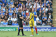 Shandon Baptiste shown the yellow card during the EFL Sky Bet League 1 match between Portsmouth and Oxford United at Fratton Park, Portsmouth, England on 18 August 2018.