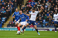 Portsmouth Midfielder, Tom Naylor (7) and Wycombe Wanderers Midfielder, Matt Bloomfield (10) challenge for the ball during the EFL Sky Bet League 1 match between Portsmouth and Wycombe Wanderers at Fratton Park, Portsmouth, England on 22 September 2018.