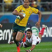 Kurtley Beale, Australia, makes a break to set up a try during the Australia V USA, Pool C match during the IRB Rugby World Cup tournament. Wellington Stadium, Wellington, New Zealand, 23rd September 2011. Photo Tim Clayton...