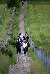 John (white tshirt near the back) on the walk..The John Hartson Foudation walk up Ben Nevis..Pic ©2010 Michael Schofield. All Rights Reserved.