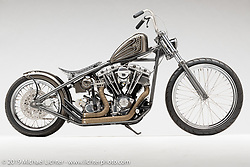 """""""'California Kid"""", silver and gray rigid chopper, built from a 1984 Shovelhead, by Peter Ballard, in  Barrington, NH.  Photographed by Michael Lichter in Sturgis, SD on 8/1/18. ©2018 Michael Lichter."""