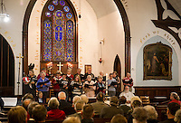 The chorus sings during the final service Sunday afternoon for the Trinity Episcopal Church in Tilton.  (Karen Bobotas/for the Laconia Daily Sun)