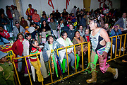 Female wrestler shouting signalling to crowd out of ring. Lucha Libre wrestling origniated in Mexico, but is popular in other latin Amercian countries, including in La Paz / El Alto, Bolivia. Male and female fighters participate in the theatrical staged fights to an adoring crowd of locals and foreigners alike.