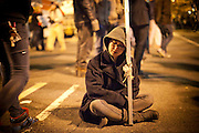 Occupy Boston protesters sit on a street after a midnight deadline in Boston, Massachusetts, December 9, 2011.