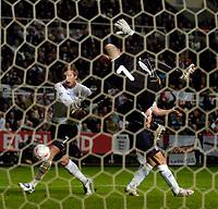 Photo. Jed Wee, Digitalsport<br /> England v Azerbaijan, World Cup Qualifier, 30/03/2005.<br /> Azerbaijan cult goalkeeper Dmitry Kramarenko's acrobatics keep England's Michael Owen (R) and David Beckham at bay.