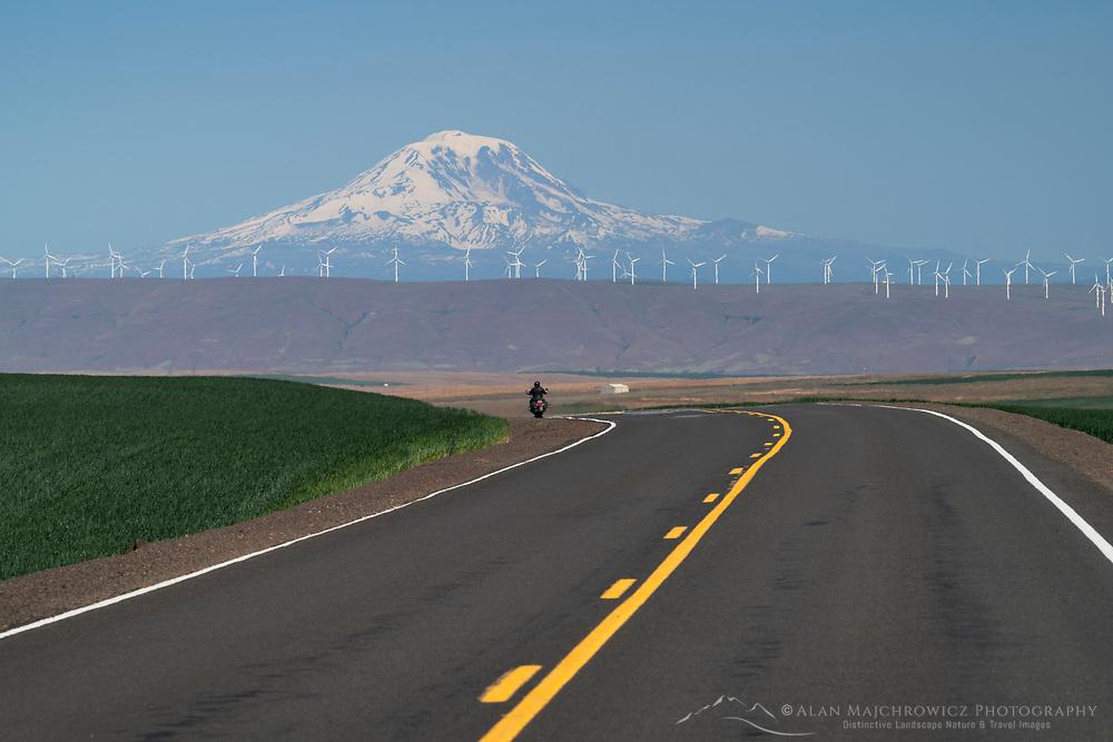 Motorcyclist on Oregon Highway 206 near Wasco Oregon. Mount Adams is in the distance