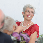Rommy Brown, wearing red, married Steve Morrow at the  Harraseeket Yacht Club today. Photo by Roger S. Duncan.