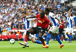 Manchester United's Romelu Lukaku (left) and Brighton & Hove Albion's Gaetan Bong (right) battle for the ball during the Premier League match at the AMEX Stadium, Brighton.