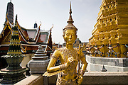 Gilt statue inside The Grand Palace and Temple complex, Bangkok, Thailand