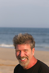 portrait of a fifty something year old man enjoying time on the beach in East Hampton,NY