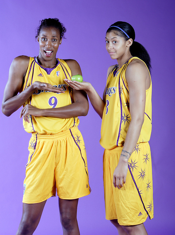Teacher and student? Lisa Leslie (#9) and Candace Parker have fun during a photo shoot in Los Angeles.