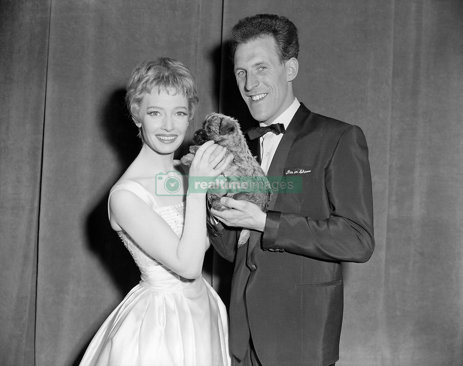 File photo dated 03/05/59 of film and TV star Jeannie Carson receiving a surprise gift, a Cairn terrier puppy, from host Sir Bruce Forsyth after the 'Sunday Night at the London Palladium' show, as the veteran entertainer has died aged 89.