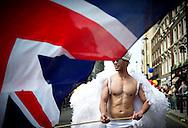 A man waiving a union jack flag, attends the annual Gay Pride parade in London, Britain, 29 June 2013. BOGDAN MARAN / BPA