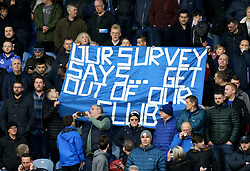 Everton fans with a banner in the stands that says 'Our Survey Says... Get Out Of Our Club' during the Premier League match at the John Smith's Stadium, Huddersfield.