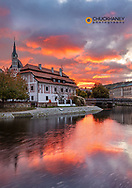 Vivid sunrise clouds above the Vltava River and Church of St Vitus in Cesky Krumlov, Czech Republic