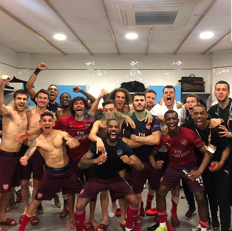 """Mesut Oezil releases a photo on Twitter with the following caption: """"""""OFF TO THE FINAL BABY!!! ❤❤ Brilliant night in Spain! 🏆🙌🏼 #TheArsenal #WeAreTheArsenal #YaGunnersYa² #M1Ö @Arsenal"""""""". Photo Credit: Twitter *** No USA Distribution *** For Editorial Use Only *** Not to be Published in Books or Photo Books ***  Please note: Fees charged by the agency are for the agency's services only, and do not, nor are they intended to, convey to the user any ownership of Copyright or License in the material. The agency does not claim any ownership including but not limited to Copyright or License in the attached material. By publishing this material you expressly agree to indemnify and to hold the agency and its directors, shareholders and employees harmless from any loss, claims, damages, demands, expenses (including legal fees), or any causes of action or allegation against the agency arising out of or connected in any way with publication of the material."""