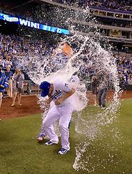 May 12, 2017 - Kansas City, MO, USA - Kansas City Royals' Brandon Moss gets the Salvy Splash from Salvador Perez after the team's 3-2 win over the Baltimore Orioles on Friday, May 12, 2017 at Kauffman Stadium in Kansas City, Mo. (Credit Image: © John Sleezer/TNS via ZUMA Wire)