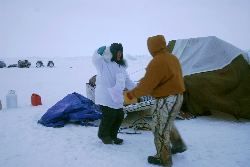 Barrow, Alaska. Captain Simmeon Patkotak greets his son and co-captain Crawford after their crew got a whale. May 2007.