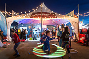 Jake Beachler spins a hula hoop at the AARP Block Party at the Albuquerque International Balloon Fiesta in Albuquerque New Mexico USA on Oct. 7th, 2018.