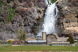 The Minnie Miller Dairy Farm.  Behind the farm is a waterfall,  the most outstanding feature of the Minnie Miller springs complex at Thousand in South Central Idaho near the town of Wendel
