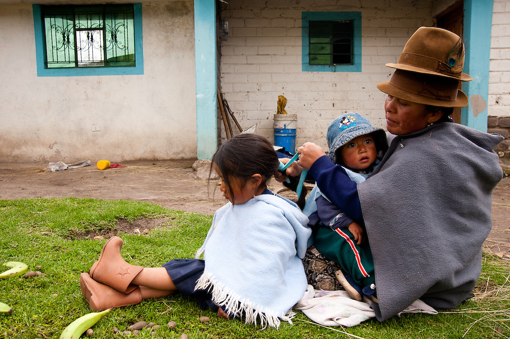 An indigenous Ecuadorian family in a remote region of the Andes prepares for school.