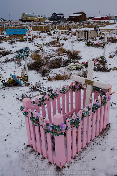 "A cemetery in Iqaluit, Nunavut Territory, Canada. With a population of 6,000, Iqaluit is the largest community in Nunavut as well as the capital city, located in the southeast part of Baffin Island. Formerly known as Frobisher Bay, it is at the mouth of the bay of that name, overlooking Koojesse Inlet. ""Iqaluit"" means 'place of many fish'."