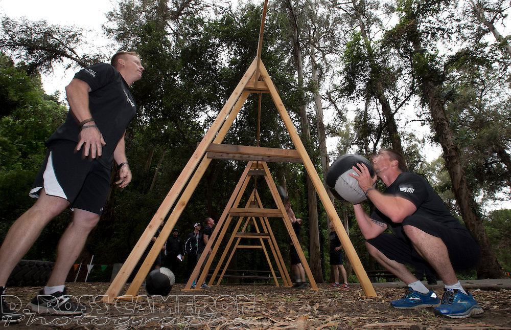 Two members of the Clovis, Calif. SWAT team loft a 20-pound medicine ball over a 10-foot crossbar -- 50 times -- at the San Leandro Police Department's 8th Annual SWAT Fitness Challenge, Thursday, May 28, 2015, 15 Lake Chabot Park in San Leandro, Calif. Nearly 40 departments sent to teams to run, jump, lift, paddle and shoot their way through the all-day competition. (Photo by D. Ross Cameron)