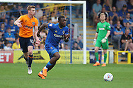 AFC Wimbledon defender Deji Oshilaja (4) clearing the ball during the EFL Sky Bet League 1 match between AFC Wimbledon and Oldham Athletic at the Cherry Red Records Stadium, Kingston, England on 21 April 2018. Picture by Matthew Redman.