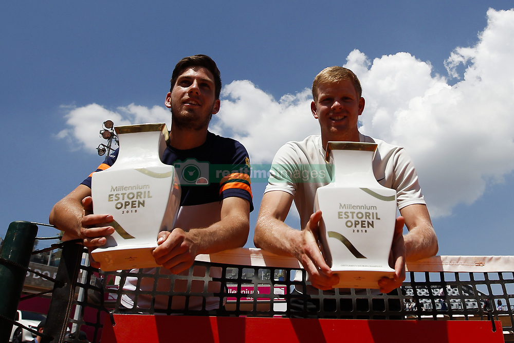 May 6, 2018 - Estoril, Portugal - Kyle Edmund (R) and Cameron Norrie (L) from Great Britain pose with their trophies after their victory against Wesley Koolhof from Netherlands and Artem Sitak from New Zealand in their Millennium Estoril Open ATP doubles final tennis match in Estoril, near Lisbon, on May 6, 2018. (Credit Image: © Carlos Palma/NurPhoto via ZUMA Press)