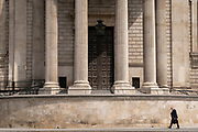 A man walks beneath the pillars and column architecture of Sir Christopher Wren's St Paul's Cathedral south transept, on 24th June 2021, in London, England. CREDIT RICHARD BAKER.
