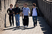 Chinese youths walk the ancient Great Wall of China at Mutianyu, north of Beijing, China